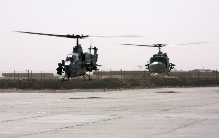 Image: AH-1W Super Cobra and a UH-1N Huey Helicopter